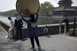 A couple during a pre-wedding photo shoot in front of the Turret of the Forbidden City, Beijing, China