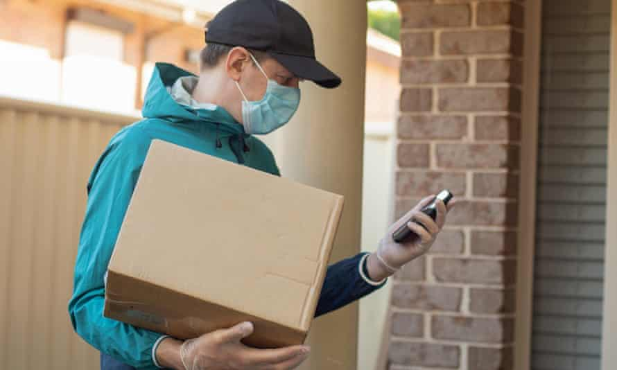 A courier delivers a parcel during the coronavirus era