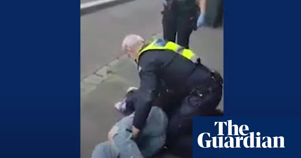 Victoria police charge woman who was filmed allegedly being choked then pinned to ground by officer – The Guardian