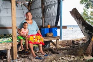 Nasaleta Setani, 54, with her nephew in a makeshift structure near the Funafuti lagoon, which they use for sleeping