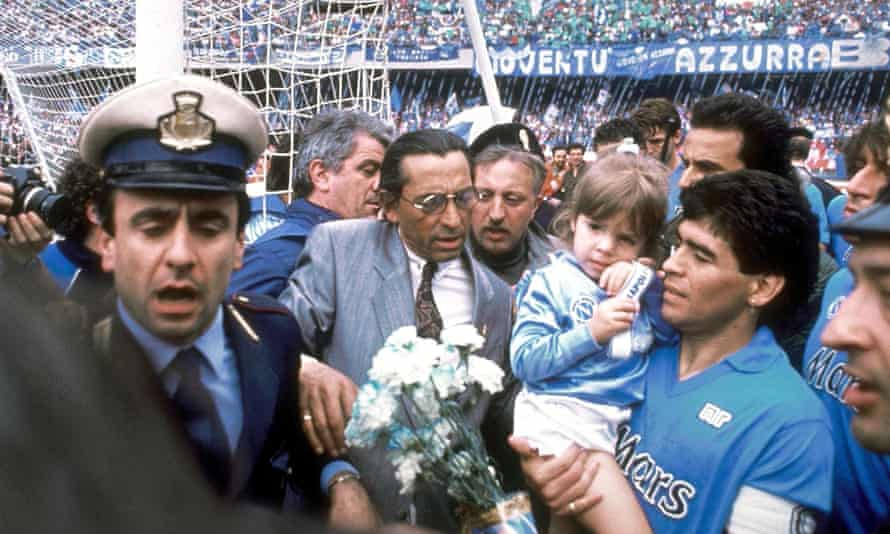 Diego Maradona and his daughter Dalma are surrounded after Napoli won their first Serie A title in 1987