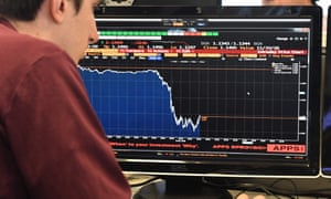 A journalist looks at a Bloomberg terminal showing the drop in the value of the pound.