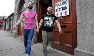 A gay couple walk hand in hand after voting in the marriage equality referendum in the Republic of Ireland last May.