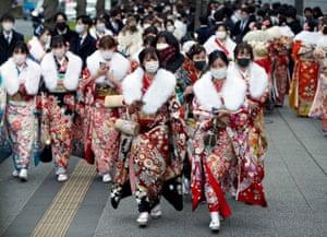 Women wearing fur stoles and kimonos