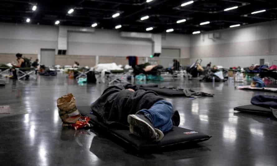 A man sleeps at a cooling shelter set up in Portland, Oregon, on Sunday.