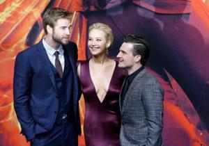 Cast members Liam Hemsworth, Jennifer Lawrence and Josh Hutcherson pose