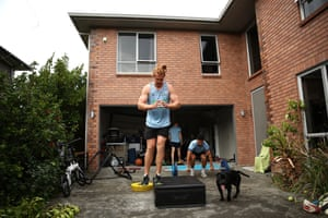 Stephen Perofeta, Finlay Christie and Tom Robinson, Blues rugby teammates and housemates, have a weights session at their garage in Auckland.