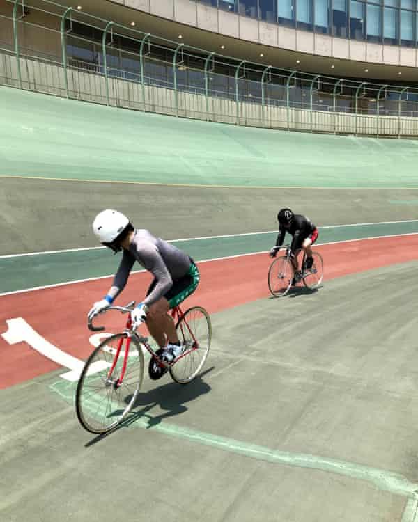 Professional keirin cyclist Ryo Okuhara keeps an eye on Guardian journalist Justin McCurry at the Kawasaki velodrome near Tokyo.