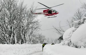 A helicopter and rescue workers on their way to the stricken Rigopiano hotel