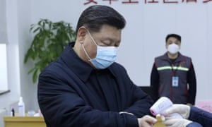 President Xi Jinping receives a temperature check at a community health centre in Beijing