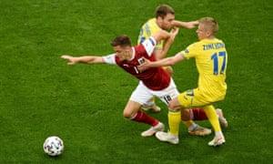 Austria's Christoph Baumgartner attempts to get free of the challenge of Ukraine's Oleksandr Karavaev (centre) and Oleksandr Zinchenko.