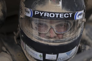 FN Speed Team driver Claude Fournier sits in his Can-Am Maverick X3 at a refuelling stop