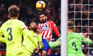 Diego Costa of Atletico Madrid heads the ball past Barcelona keeper Marc-Andre Ter Stegan to give the home side the lead.