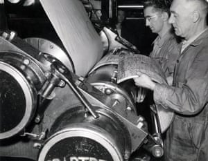 Two print workers clamping stereotype plates onto the printing cylinders of a rotary press in the Guardian machine room, undated, circa 1940s. These high speed rotary presses allowed 1000s of newspapers to be printed per hour. (Archive ref: GUA/6/9/1/4/G box 3)