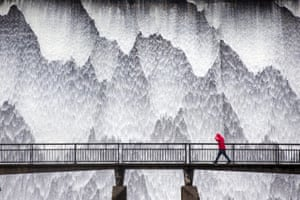 Water cascades down the 21 metre high dam wall at Wet Sleddale in Cumbria