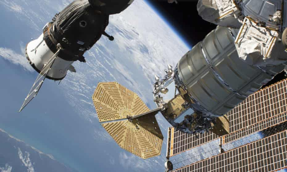 View of the International Space Station with Soyuz module on the left.