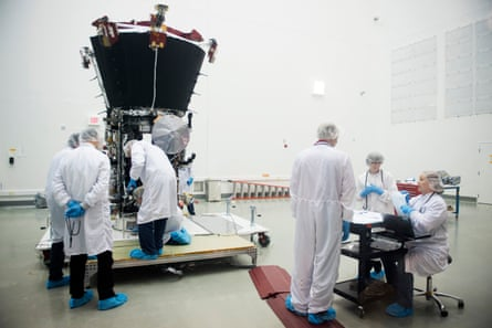 engineers examine the parker solar probe in a nasa lab in greenbelt maryland