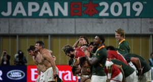 South Africa's and Canada's players bow to the crowd after the match.