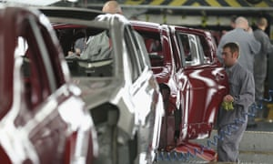 A worker assembling cars at Nissan's plant in Sunderland
