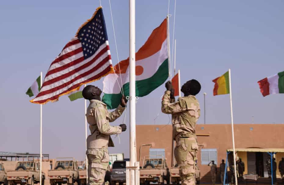 Soldiers raise the Nigerian and US flags during a ceremony in Agadez in April.