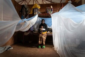 Fayina Nabatesi sits with one of her six children in a room in the Nyarushishi transit centre in western Rwanda.