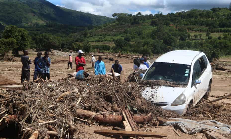 Survivors of Cyclone Idai inspect flood wreckage in the village of Kopa, Zimbabwe, on Thursday.