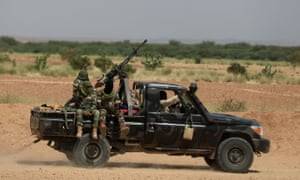 Nigerien soldiers riding a truck outside Agadez