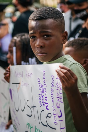St Paul, Minnesota, US: a boy stands with a sign during a demonstration to demand a stricter reform of police legislation