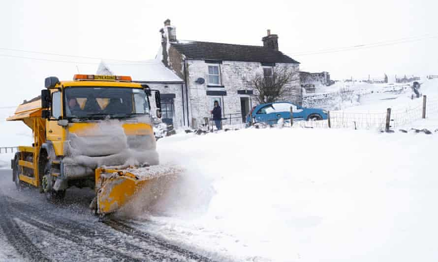 A snow plough makes its way along a snow-covered road in the village of Harwood in Teesdale, County Durham, on Wednesday
