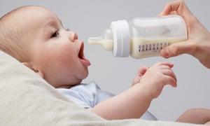 A baby being fed a bottle.