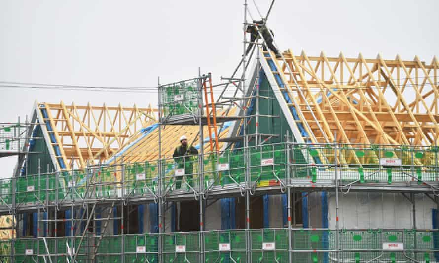 Builders work on a £7.8m housing estate by construction company Seddon, in Burslem, England