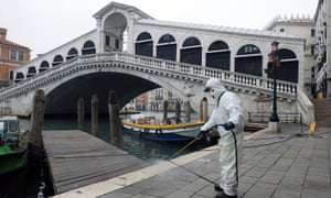 A worker sanitises the Rialto Bridge on 13 March.