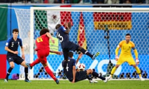 Belgiium's Axel Witsel lets fly but he is denied by Hugo Lloris between the French sticks.