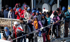 Migrants and refugees disembark from a vessel in Catania harbour, Italy