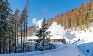 White snow and blue sky: A historic steam train that runs at full speed to Brocken mountain in the Harz region.