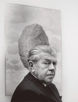 René Magritte Shunk Kender Rene Margitte in front of Le sens de realite