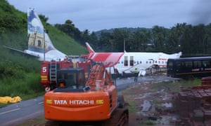 The wreckage of the Air India Express jet, at the foot of the elevated runway at Calicut international airport.