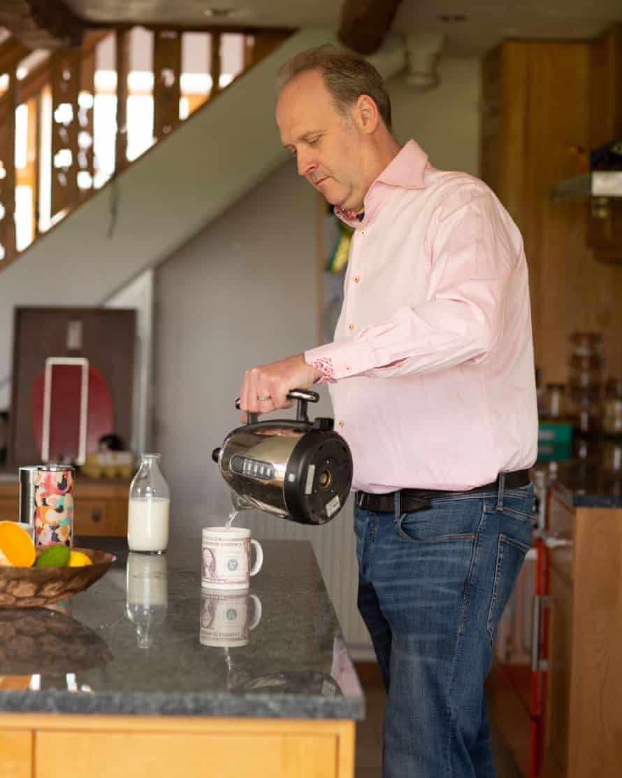 Simon Daniel making a hot drink in his kitchen.
