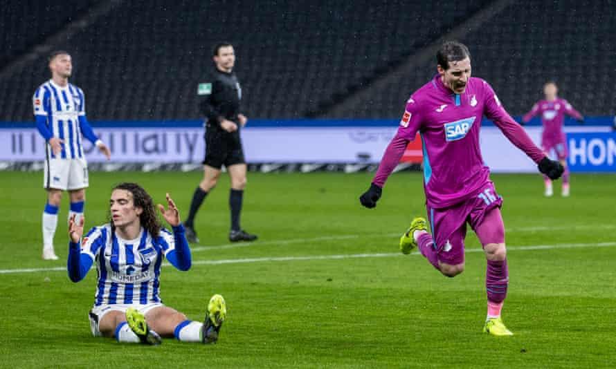 A despondent Matteo Guendouzi looks on as Sebastian Rudy celebrates Hoffenheim's opening goal.
