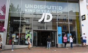 Shoppers observing social distancing in June, outside a JD Sports store, England