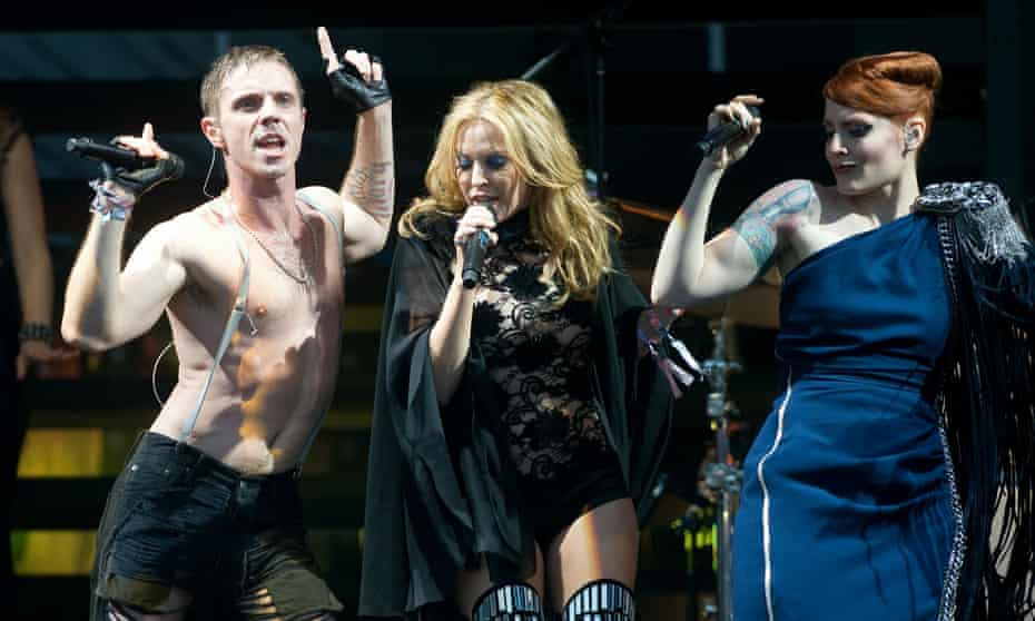 Jake Shears and Ana Matronic of Scissor Sisters perform with Kylie Minogue at the 2010 Glastonbury festival.