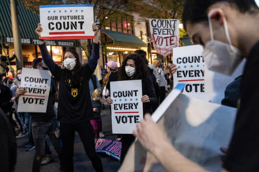 People dance and hold signs during a protest in support of counting all votes as the election in in the state is still unresolved on November 5, 2020 in Philadelphia, Pennsylvania.