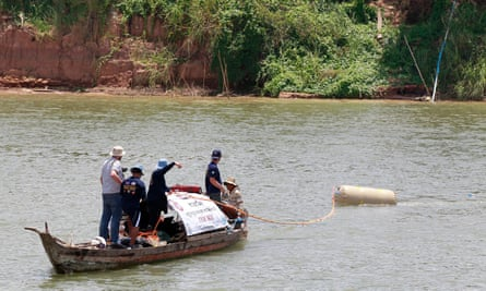 Divers search for an aircraft bomb during a diving operation in the Mekong river in Kandal province, Cambodia.