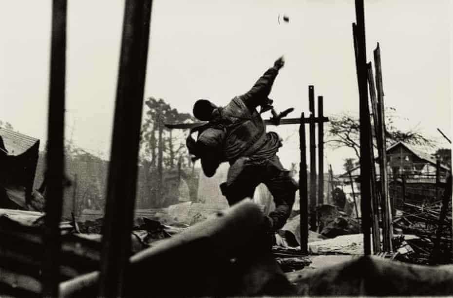 Grenade thrower, Hue, Vietnam 1968 by Don McCullin.