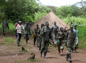 Lord's Resistance Army fighters emerge from thick bush in Ri-Kwangba on southern Sudan's border with the Democratic Republic of Congo, in September 2008.