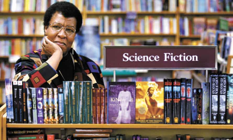 Author Octavia Butler poses near some of her novels at University Book Store in Seattle.