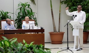 Farc lead negotiator Ivan Marquez addresses the audience while Colombia's lead government negotiator Humberto de la Calle and mediator Dag Nylander of Norway look on.