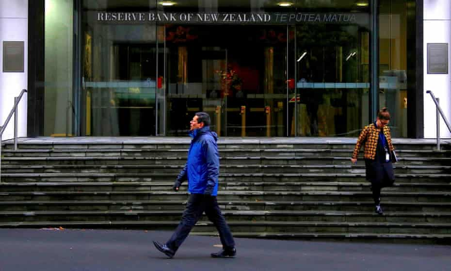 Pedestrians walk near the main entrance to the Reserve Bank of New Zealand located in central Wellington, New Zealand