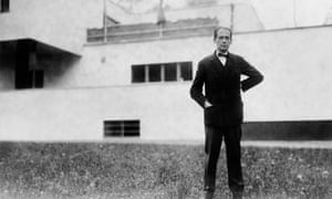 Walter Gropius, in front of a house designed by him, in 1927