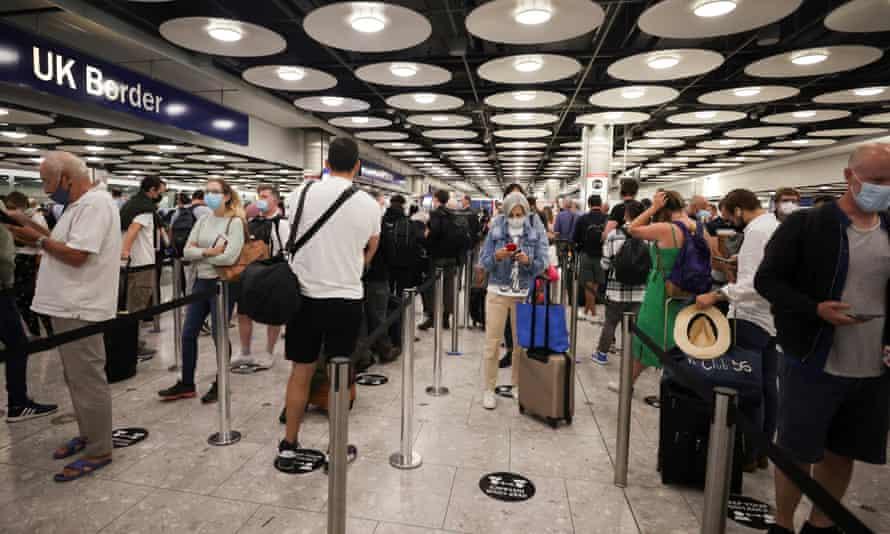 Passengers arriving at UK Border Control, Heathrow airport, London, late June